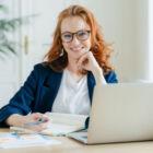 female-freelancer-has-remote-work-watches-webinar--XVRD2MM